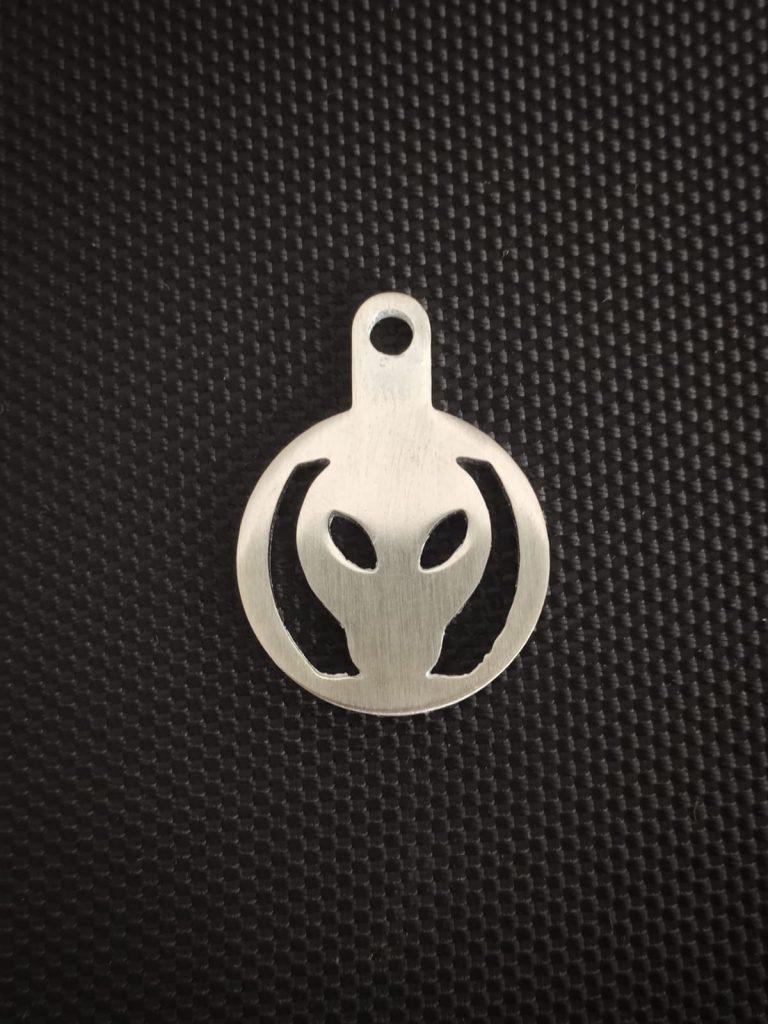 TGIFF alien face stainless steel token