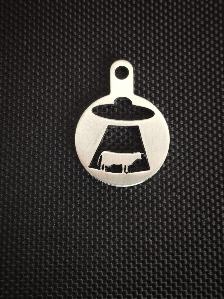 Ufo abductiong cow stainless steel token